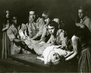 """Futz."" Men holding body, Jerry Cunliffe, VICTOR LIPARI, ROB THIRKIELD, man observing right MICHAEL WARREN POWELL."