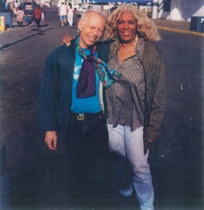 JEAN-CLAUDE VAN ITALLIE and ELLEN STEWART, Santa Monica pier, 1990's. See them in the 1960s HERE.